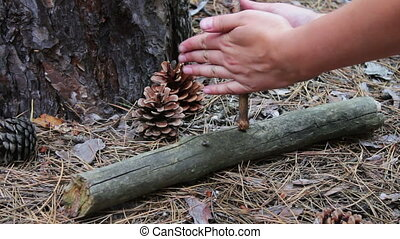 Woman tries to breed a fire in the forest with the help of...