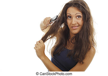 Woman tries to comb her detangled hair