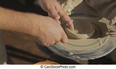 Woman tries to learn art of pottery for first time in her life.