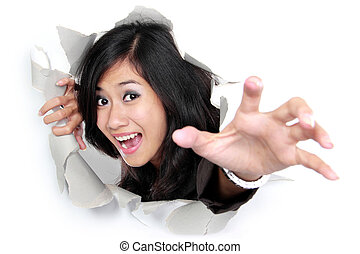 woman try to get out through a hole in the paper. Isolated...