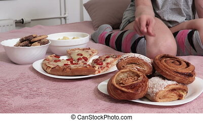 Woman try to make choice between unhealthy food