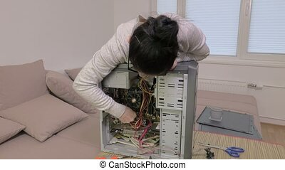 Woman try to repair computer