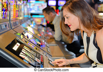 woman trying her luck in the casino