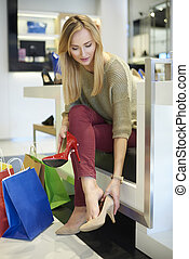 Woman trying on a new pair of shoes