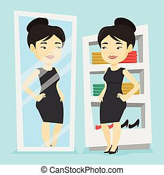 Woman trying on clothes in dressing room.