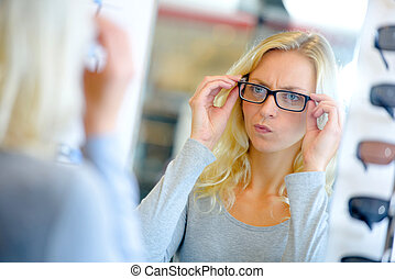 Woman trying on some glasses