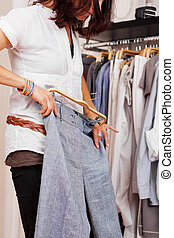 Woman Trying Trouser In Clothing Store - Midsection of mid ...