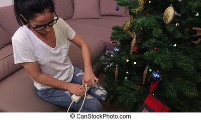 Woman turn off and turn on Christmas lights
