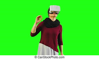 Woman Turning her Head with a VR Headset On.