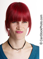 woman turns nose - a young woman with red hair turns nose