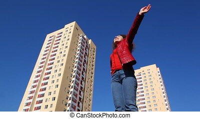 woman turns raising hands upward and outward - young woman...