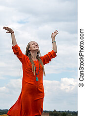 woman turns to the sky