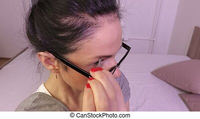 Woman tweeze eyebrows