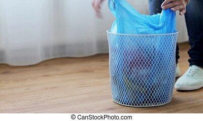 woman tying bag with garbage in waste bin - people,...