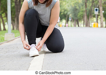 Woman tying shoe laces