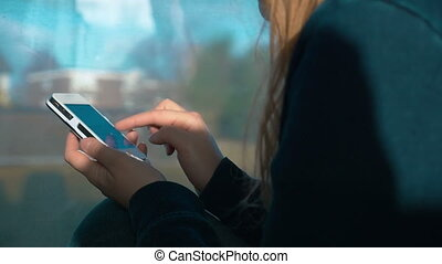Woman Typing a Message on Smartphone