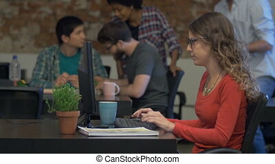 Woman typing computer, Business people office group sitting desk