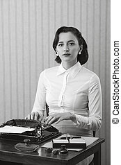 Woman typing in her office