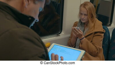 Woman Typing in Smartphone while Riding the Subway