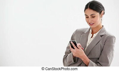 Woman typing on a cellphone