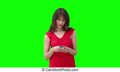 Woman typing on her phone before looking to her side