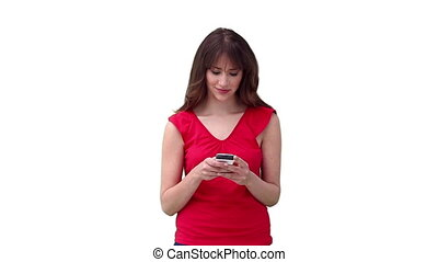Woman typing on her phone before looking at the camera