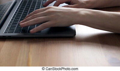 Woman typing on laptop