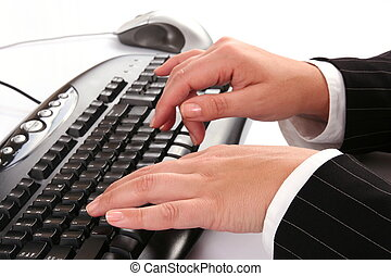 Woman typing on the computer keyboard
