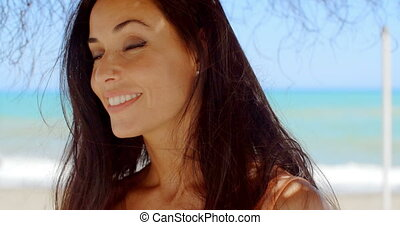Woman Under a Beach Umbrella Smiling at Camera - Close up ...