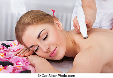 Woman Under Going Microdermabrasion Treatment - Young...