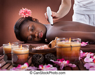 Woman Undergoing Microdermabrasion Therapy At Spa - Side...