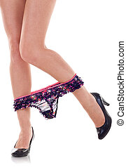woman undress panties - Legs of a young woman while undress...