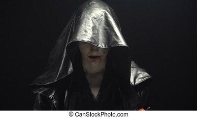 Woman undressing black hood