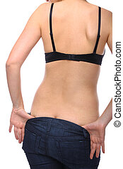 Woman undressing with back facing the camera