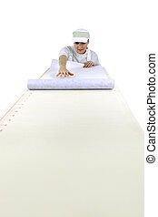 Woman unrolling wall paper