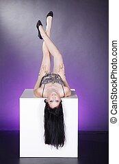 woman upside down on cube
