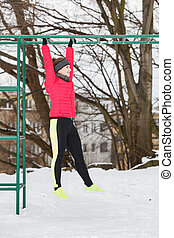 Woman urban exercising outside during winter