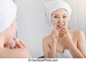 woman use dental floss white healthy with mirror in bathroom