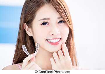 woman use invisible braces - Beauty asian girl hold ...