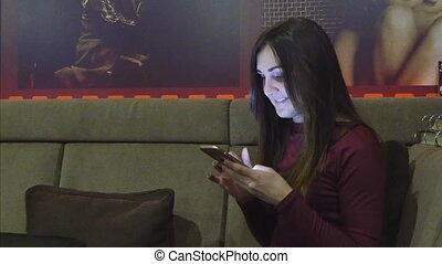 Woman use smartphone in cafe