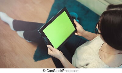 Woman Use Tablet Pc Sitting near Sofa - Indoor shot of a...