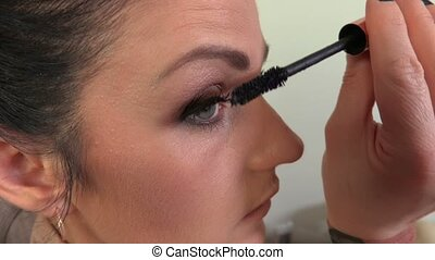 Woman uses mascara