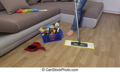 Woman uses mop on the floor