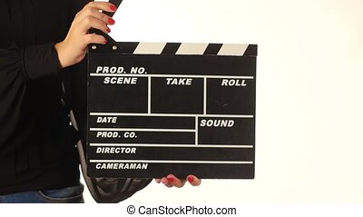 Woman uses movie production clapper board, on white - Woman...