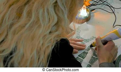 Woman using 3D printing pen