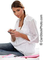 Woman using a calculator at home