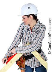 Woman using a carpentry plane