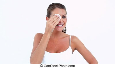 Woman using a cotton pad against white background