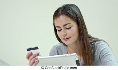 Woman Using a Digital Tablet Lying at Home