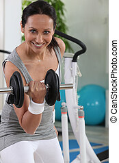Woman using a dumbbell